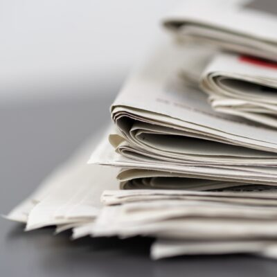 closeup-shot-of-several-newspapers-stacked-on-top-of-each-other